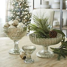 Mercury Glass vases with gold and silver ornaments with springs of greenery