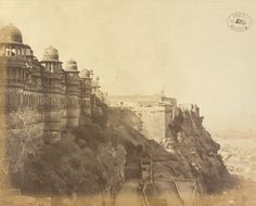 East face of Man Mandir and Fort, Gwalior. This photograph shows the fort of Gwalior, looking northwards along the east side of the fort plateau with the exterior of the Man Mandir palace in the foreground and the Vikram Mandir beyond. The Man Mandir was built by Raja Man Singh as his royal residence between 1486 and 1516, while the Vikram Mandir was built for Vikramaditya shorty before the outset his brief reign between 1516 and 1518.