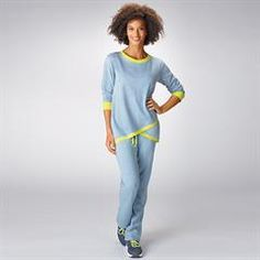 Avon's Cool Casual Lounge Set features a blue crossover top with lime green trim and relaxed fit pants. Wear together or separately. On-trend athleisure set. Avon Fashion, Fashion Brands, Avon Clothing, Beauty Boutique, Athleisure Outfits, Weekend Style, Signature Collection, French Terry, Avon Products