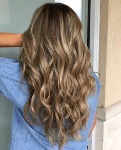 Layered V-Cut with Blonde Balayage