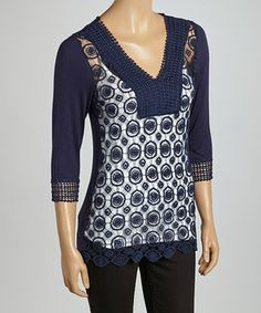 This fancy top creates a fashionable ensemble with circle-designed crochet. Its v-neck silhouette and three-quarter sleeves are sure to set a stylish statement, while its cotton-spandex construction is oh-so comfy.
