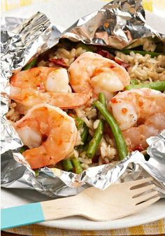 Backyard Shrimp and Rice Bundles -- A zesty mix of KRAFT Italian Dressing, beans, rice and tomatoes are bundled with shrimp in foil packets on the grill for a tasty recipe with easy cleanup, ready for the dinner table in less than 30 minutes. Grilling Recipes, Fish Recipes, Seafood Recipes, Dinner Recipes, Cooking Recipes, Healthy Recipes, Recipies, Foil Pack Meals, Foil Dinners
