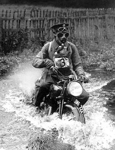 "Not a ""Cafe"" bike, -  but a WW-1 military dispatch rider all decked out in his battle gear."
