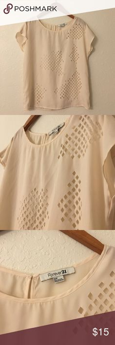 Forever 21 flowy cutout blouse in size small This is a flowy cutout blouse from Forever 21 in size small.  It is in a beautiful cream color.  I got so many compliments when I wore this unique top. Only worn once for an event.  It is a size small but can easily fit a xs, s, or m due to the loose fit.  In great condition from a pet free, smoke free home. Forever 21 Tops Blouses