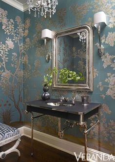 Statement wallpaper. A charcoal sink nearly floats against the teal and silver wallpaper in this gorgeous bathroom. The vanity and fittings are by Waterworks, the scones are by Circa Lighting.