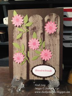 """SU  I cut crumb cake card stock 1"""" x 5 1/4"""" to make the fence planks.  to add the weathering on the planks I just drug the early expresso stamp pad down each plank.  The 1 1/4"""" circle punch was used to round the tops of the planks.  The flowers were the centers of one of the mixed bunch flowers that was punched out with the boho blossom punch."""