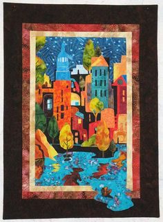 """Sheryl Martin's first cityscape quilt called """"City Nights."""" (19""""x26"""")"""