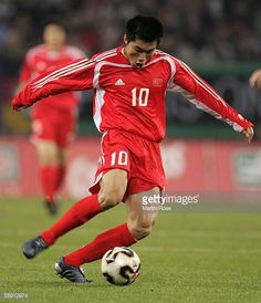 Zhi Zheng of China runs with the ball during the friendly game between Germany and China at the AOL Arena on October 12 2005 in Hamburg Germany