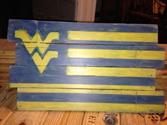 For Sale on my Etsy site!  WVU Mountaineers pallet painting. Stained and painted to create that weathered look.
