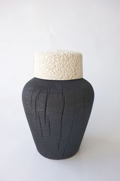 The Triumph of Galatea by Leah Jensen. Porcelain and charred timber.