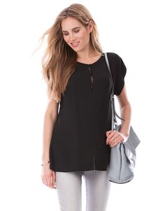 Soft woven fabric   Invisible zipper front for breastfeeding   Adjustable neckline   Anti-crease fabric   Short sleeves    Chic, lightweight & crease-resistant with easy access for nursing, if there was ever an essential style for a new-mom, this is it! Ultra-light & woven, this black nursing top offers a relaxed easy fit with plenty of room to grow, making it perfect throughout pregnancy & beyond. After baby is born an invisible zipper runs down the front, providing easy access...