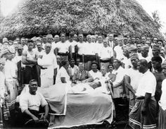 The lying in state of Tupua Tamasese Lealofi III, Samoa, 1929.  Amongst those around the coffin are, from left to right: Faumuina Fiame Mulinu'u I (seated in foreground), Tamasese's son (above Faumuina, with folded arms), Tuimaleai'ifano (with arm in a sling), Mrs Ala Tamasese (seated, in profile), and two European Mau supporters, Alfred Hall Skelton and Alfred G. Smyth.
