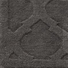 Moorish Tile Rug, charcoal grey.  This wouldn't be too bad for the bedroom.