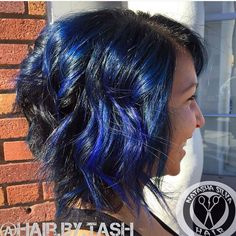 Textured angled a line lob with fun royal blue balayage highlights color