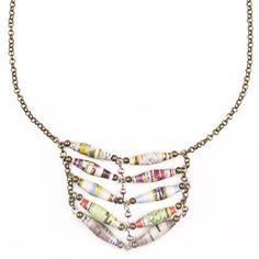 Roxie Necklace – Handmade beads created from recycled magazines are used to create this unique pendant on the Roxie Necklace.  Complete the look by pairing the necklace with the Laityn Bracelet.