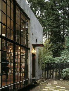The Brain - some director's house outside Seattle - Olson Kundig architect. I've been in this house. Really beautiful with two story ceiling and bookcases up the walls. More like a studio. The main house is separate.
