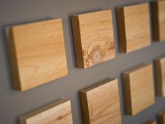 Carpenter David Brown created a unique geometric pattern on the walls of this space using 2.5-inch cedar squares installed in a grid pattern. Rather than traditional wood walls, this art installation is both modern and rustic at once.