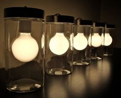 Lights in jars at https://www.etsy.com/listing/102589556/sale-modern-glass-tube-table-light-glass
