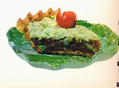 Summer Salad Pie from Betty Crocker's Dinner in a Dish, 1965 - can always count on Betty to come up with something..... unusual..... lemon jello mixed with tomato sauce, celery, olives (of course) and onion in a cheese crust, but wait - topped with tuna salad - oh and a radish flower. oooff!