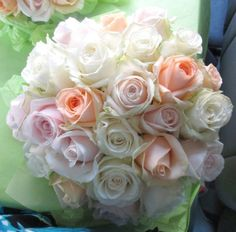 Handtied bouquet of Avalanche roses in peach, pink and ivory