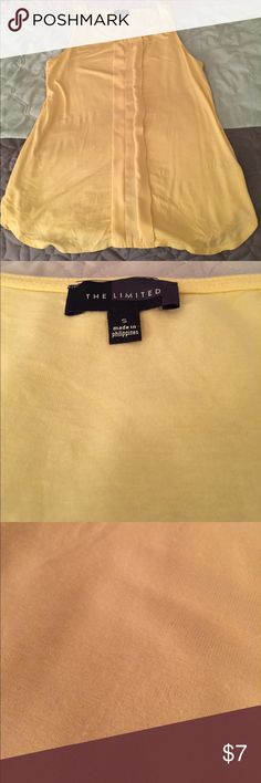 The LIMITED size small sleeveless yellow blouse NOTE: some piling as seen in picture 3. Otherwise in excellent condition. Sleeveless yellow blouse from the Limited in size small. Perfect for the summer. The Limited Tops Blouses