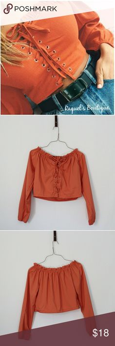 Paige Crop Top in Orange Details: Off the shoulder lace-up front long sleeve crop top with ruffled neckline  Brand: Boutique Brand  Size: Medium Measurements: Bust/32-34 inches Waist/32 inches Length/12-14 inches  Size: Large Measurements: Bust/34-36 inches Waist/34 inches Length/12.5-14.5 inches  Condition: New and packaged with boutique tags Tops