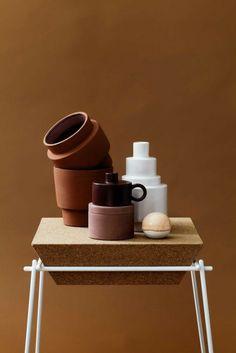terracotta home decor on cork side table interior design trends 2017