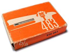 """(Branding stripped of decoration) Koh-i-noor staples packaging for office staples with Constructivist, """"no-nonsense graphics: silhouette of a stapler (with a staple strip in place) and the product ID number. KIN stands for Koh-i-noor factory."""" c. 1970s. Caption from link"""