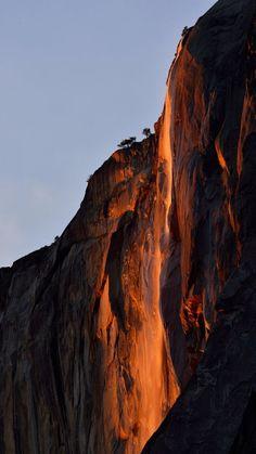 Magical light falls upon Horsetail Falls in Yosemite National...