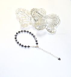 Swarovski Crystals Bracelet   A very simple but elegant bracelet is created with 6mm Silvernight Swarovski bicones strung on Beadalon wire and finished with silver plated findings. Measures 6 ¾ inches (small) with a 2 ¼ inch extender. Shipping is Free. $26.00