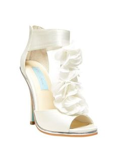 """This eye-catching chiffon floral t-strap sandal will be the perfect addition to your special day!  Blue by Betsey Johnson T-strap sandal features delicate and stunning chiffon floral detail.  Heel measures 4.5"""".  Available in Ivory.  Fully lined. Imported."""