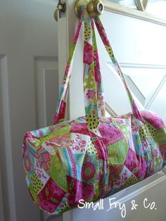 Kid Size Duffle Bag, could be a good overnight bag as well.  So making one for Elle.  Think i would sew the handles onto the outer fabric before putting it all together.