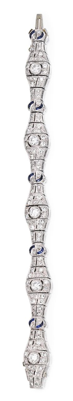 PLATINUM, DIAMOND AND SAPPHIRE BRACELET Of openwork design, set with six old European-cut diamonds weighing approximately 1.60 carats, accented by numerous smaller old European and single-cut diamonds weighing approximately 3.60 carats, further decorated with 24 calibré-cut sapphires, length 7½ inches; circa 1930.