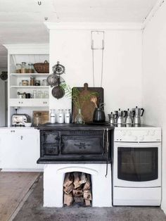 A basic kitchen in the idyllic Swedish summer cottage of Carina Olander.