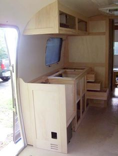 Kitchen cabinet built and Magic Chef thermostat all over the camper - Airstream Forums