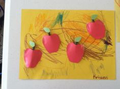 The color of the week was red. We made apples made out of construction paper with parts of a real tree branch for the stem.