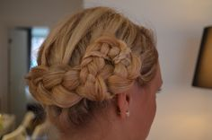 My hair updo. The small braid twisted around the big one is key! (and yes your arms cramps after a while )