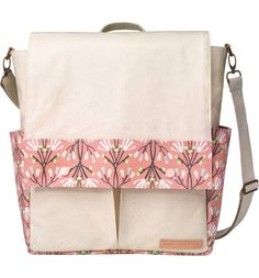 Cute pink baby girl diaper bag | Convertible backpack diaper bag from Petunia Pickle Bottom | Best floral print baby bag | Meet the Petunia Pickle Bottom Pathway Backpack Diaper Tote | A convertible crossbody tote that switches from over-the-shoulder to backpack carry with quick strap changes is presented in two-tone canvas and has a secret identity—it's a well-appointed diaper bag! {Ad}