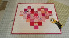Quilted Scrappy pixelated heart table topper by QuiltsClothsCovers