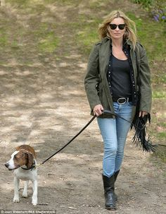 Hot to trot: Supermodel Kate Moss walked her dog Archie in the woods in Oxfordshire on Saturday - along with a host of her friends, including Liv Tyler and her boyfriend Dave Gardner