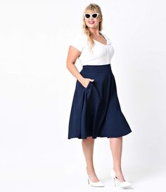 Vivien is short for va-va-voom, dames! An exquisite 1950s reminiscent navy plus size swing skirt that rests high on the natural waist, the Vivien skirt is a chic stunner! Fabulously created by Unique Vintage, featuring functional side pockets, thick bandi