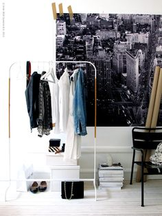 open closet, clothes rack, wall picture
