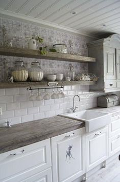 Great neutral kitchen inspiration picture! I really love how they used 2 different tiles. Plus the concrete counter tops are perfect!  #Inspiration #Kitchen #Greenbasementsandremodeling #AtlantaConstruction #roswellremodel
