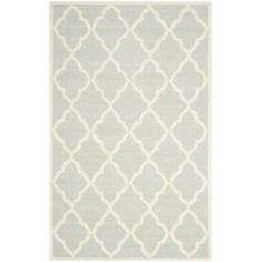Soften your bedroom or living room scheme with this hand-tufted rug, showcasing a trellis motif in light grey tones. Team with glossy white furniture and a varied grey colour palette for a sense of contemporary elegance.  Product: RugConstruction Material: WoolColour: Light grey and ivoryPile Height: 1.14 cm Note: Please be aware that actual colours may vary from those shown on your screen. Accent rugs may also not show the entire pattern that the corresponding area rugs have.Cleaning and…