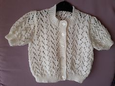 A pretty little short sleeved lace cardigan, perfect for those cooler summer days. Knitted over a 6 row lace pattern which is easy to follow. Sizes are 20, 22 and 24 inches - finished sizes 22, 24 and 26 inches ( 51, 56, 61 cm finished size 56, 61, 66cm).
