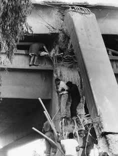 Loma Prieta earthquake. John and Maedell Stafford are helped from the lower deck of the Cypress structure at West Grand Avenue, Oakland by a neighbor/passerby on October 17, 1989. West Oakland neighbors and workers brought their own ladders and rope and climbed into the wreckage to help. This is one of a series of photos that won the Oakland Tribune the 1990 Pulitzer Prize for Spot News Photography.  (Roy H. Williams/Bay Area News Group Archives)