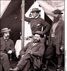 """Allan Pinkerton (center) & Kate Warne (back).  Warne (1833-1868) came to Pinkerton as a widow answering an ad for a detective. Kate argued that women could be """"most useful in worming out secrets in many places which would be impossible for a male detective."""" Warne successfully worked high profile cases, including protecting Abraham Lincoln from an assassination plot by smuggling him through Baltimore in a series of disguises.  She died of pneumonia and is buried in the Pinkerton family plot."""