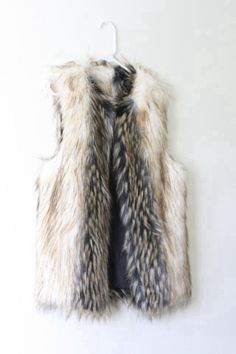 The fur vest - keep it long or short, for classic layering wear it over a (denim) blouse. A must-have. For fashion statements wear with different patterns colors or fabric. Preferably warm tints.