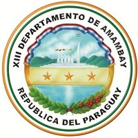 """COA of Amambay is a department in Paraguay. The capital is Pedro Juan Caballero. The name comes from the way a part of the Caaguazú Cordillera is called, """"Amambay Cordillera"""". Amambay is the name of a fern, typical of the forest in the region. After the Paraguayan War, vast expanses of land passed to the hands of foreign businessmen dedicated to exploiting yerba mate and lumber"""