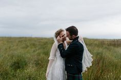 Lauren wears an original vintage 1940s wedding dress and veil for her elegant and colourful wedding at Crear in Scotland. Photography by Caro Weiss.